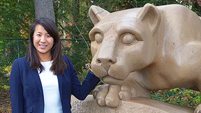Angie Chang with lion shrine