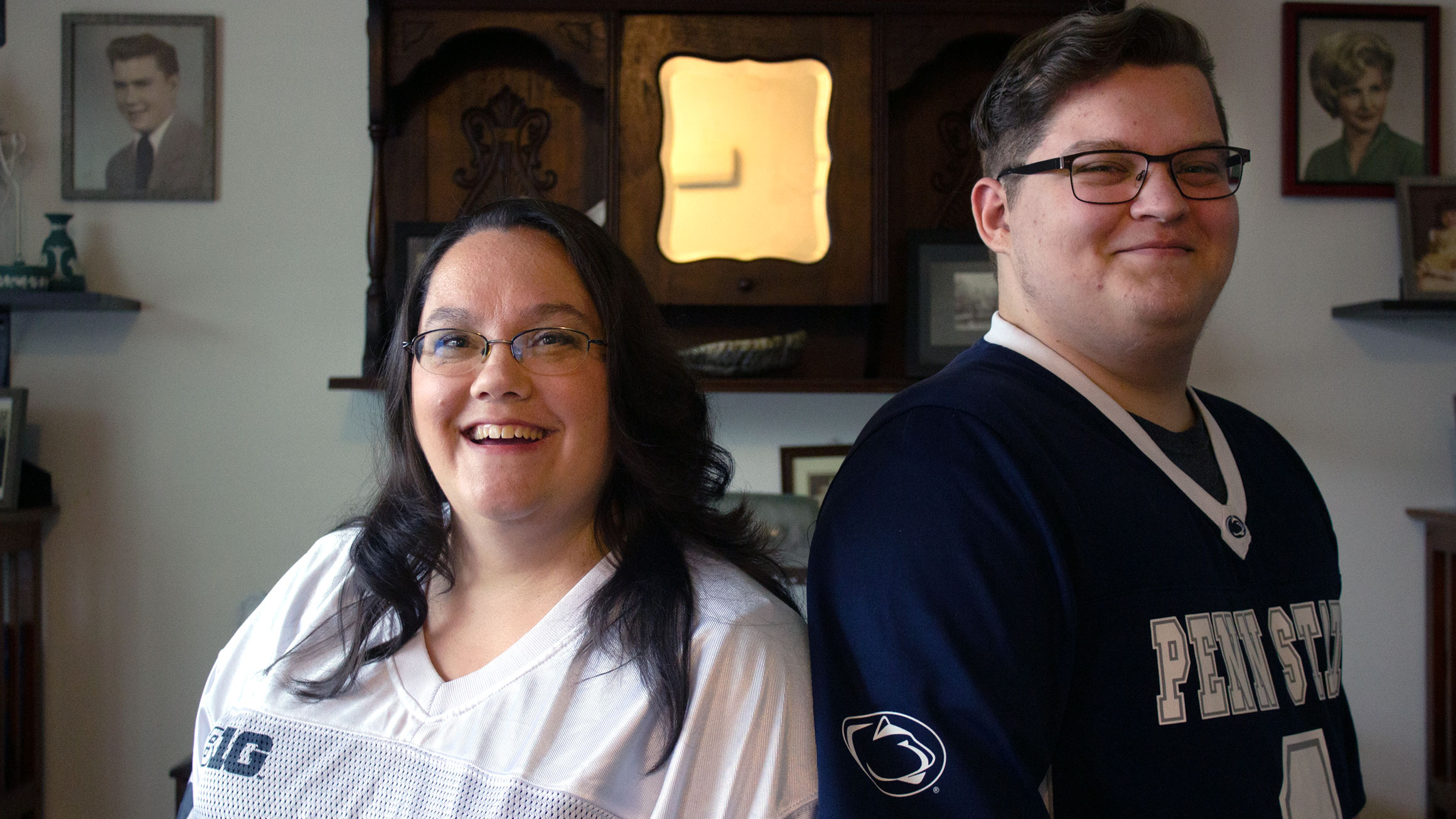 A portrait of Stephanie Files on the left and her son Josh Files on the right with both wearing Penn State football jerseys