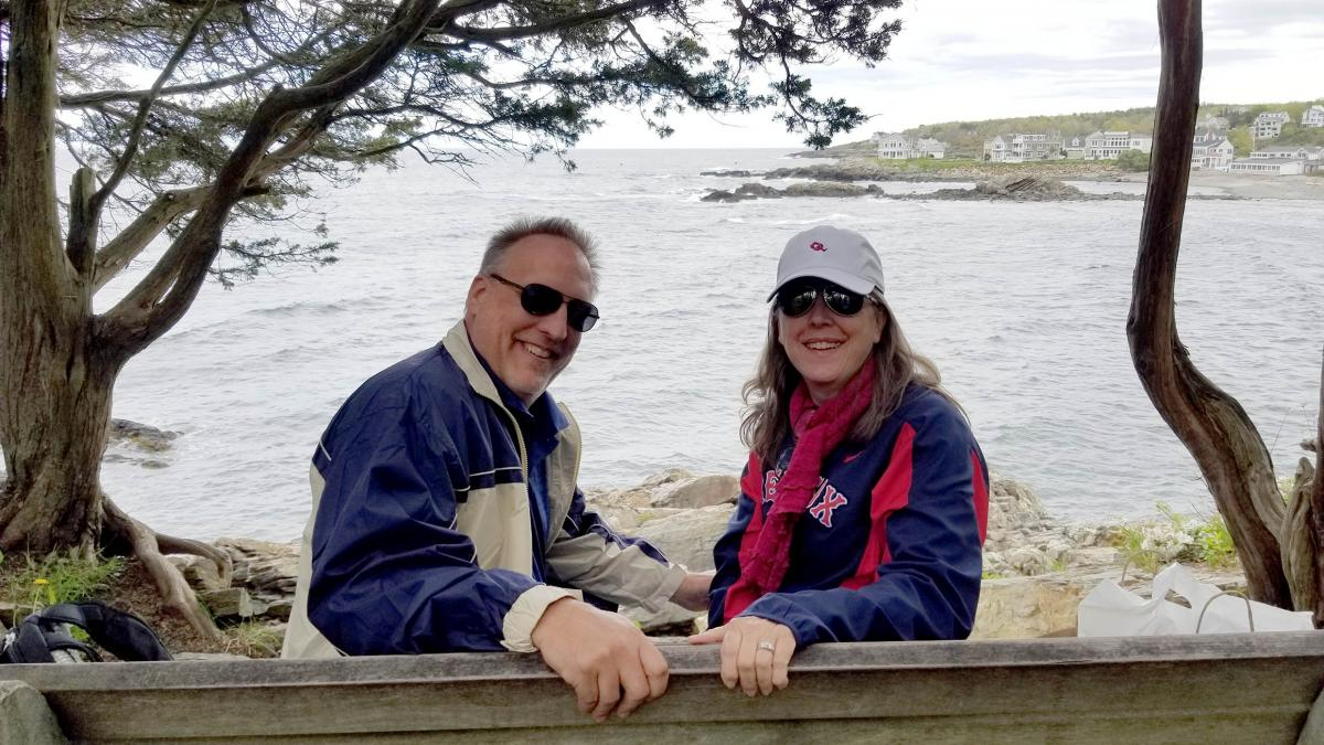 Mary Thomas is pictured with her husband on the shore of a lake.