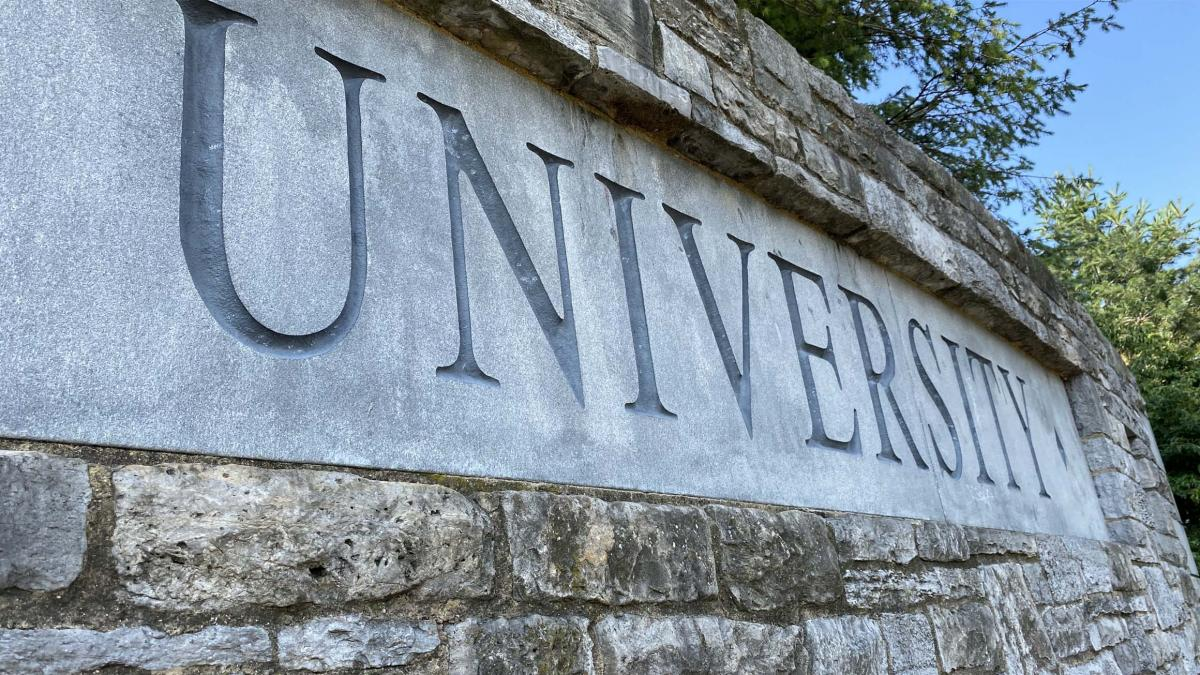 "The ""University"" of the ""Pennsylvania State University"" sign is shown."