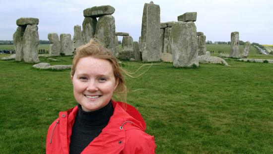 Meckler stands in front of Stonehenge