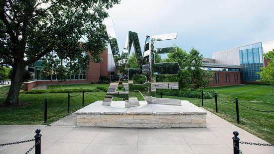 "The We Are shrine at Penn State shows the word ""We"" on top of ""Are"""