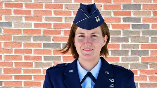 A portrait of Lauren Maloney in a blue military uniform