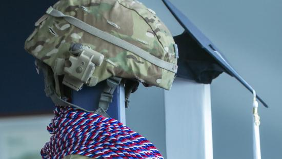 Military helmet on stand with military honor cords