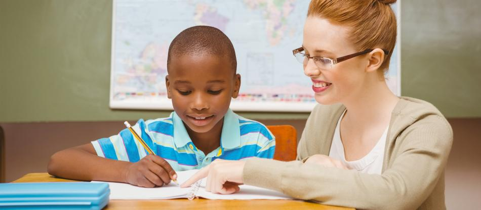 Educator working with a student