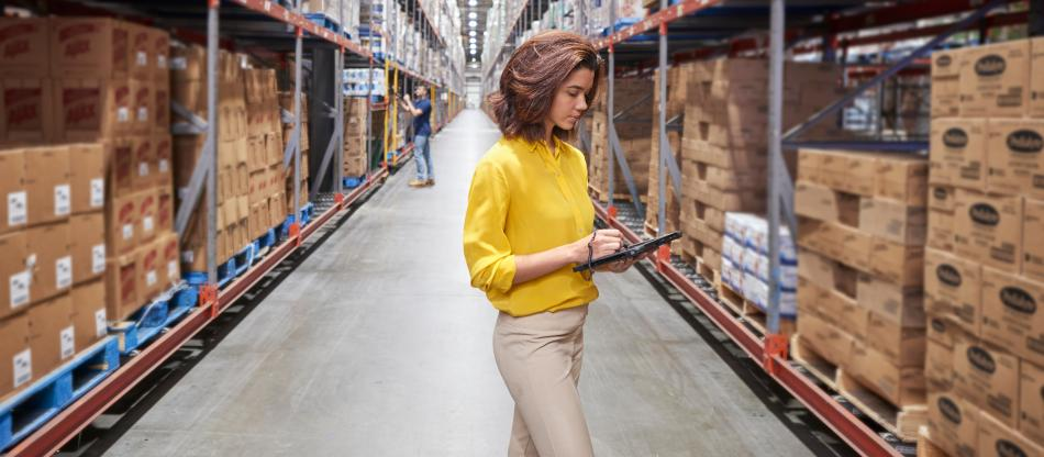 Woman working on a tablet in a warehouse