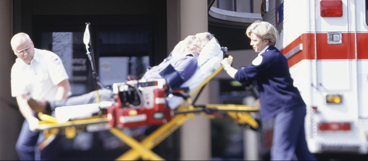 Stretcher being rushed into an emergency room