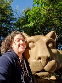 Emily Bowmer takes a selfie in front of the Nittany Lion Shrine at Penn State.